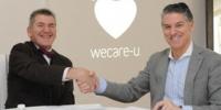 Firma acuerdo con WECARE-U